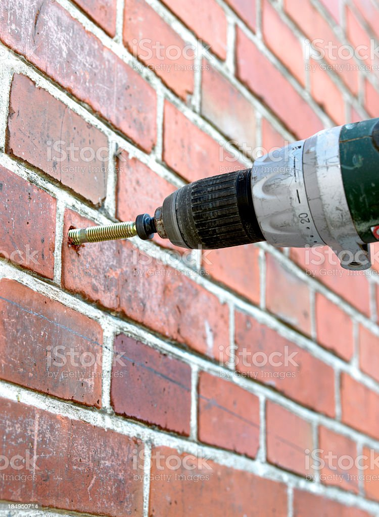 Mounting i brick wall stock photo