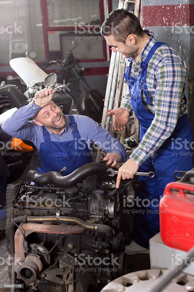 Mounting specialists in coveralls working stock photo