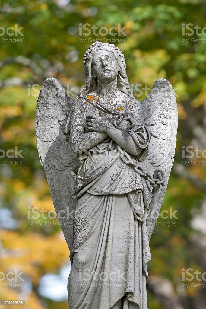 Mournful statue of chained angel stock photo