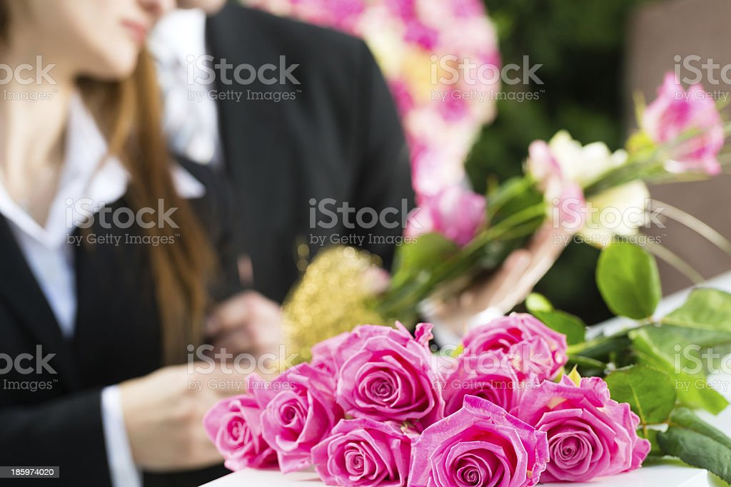 Mourning People at Funeral with coffin stock photo