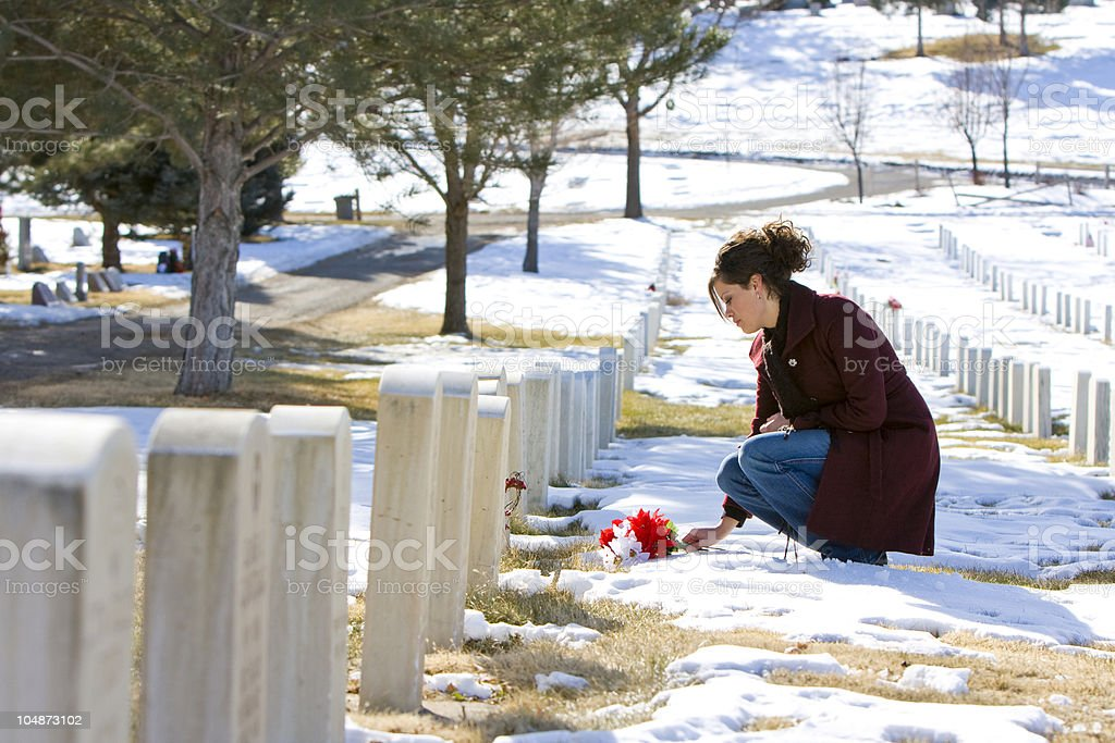 Mourning Young Woman at Graveside stock photo