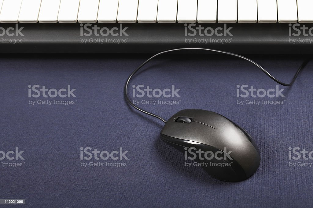 Mouse and piano keyboard stock photo