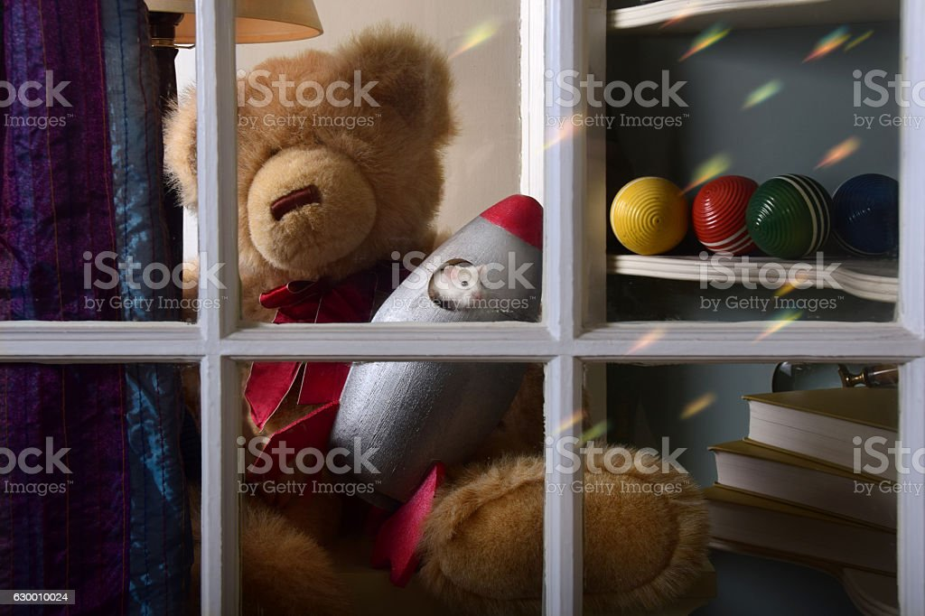 Mouse in Retro Rocket Toy in Window of Childs Bedroom stock photo