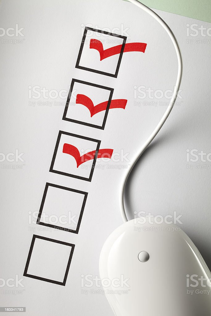 Mouse on a questionnaire royalty-free stock photo