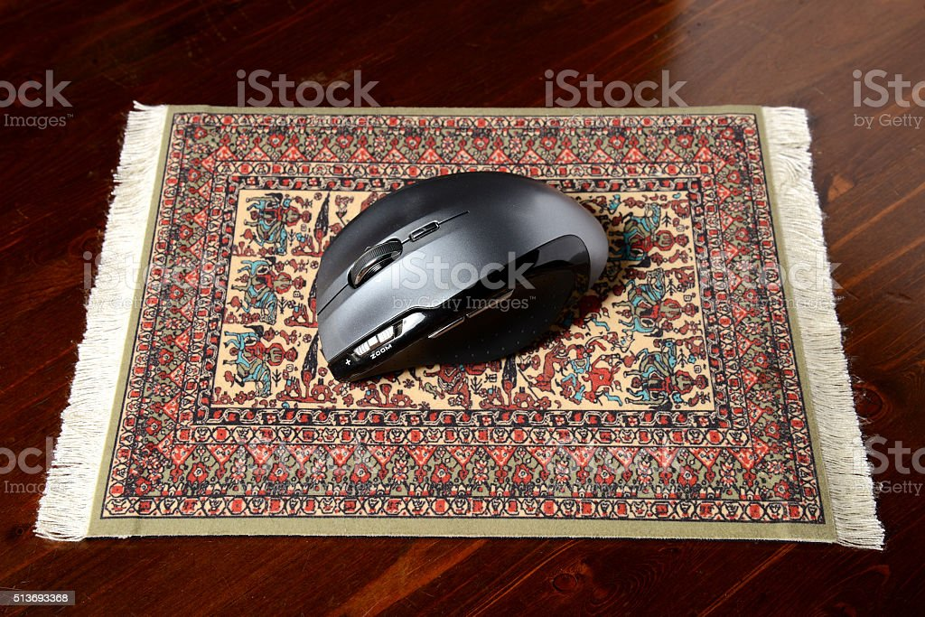 mouse on a real carpet pad stock photo