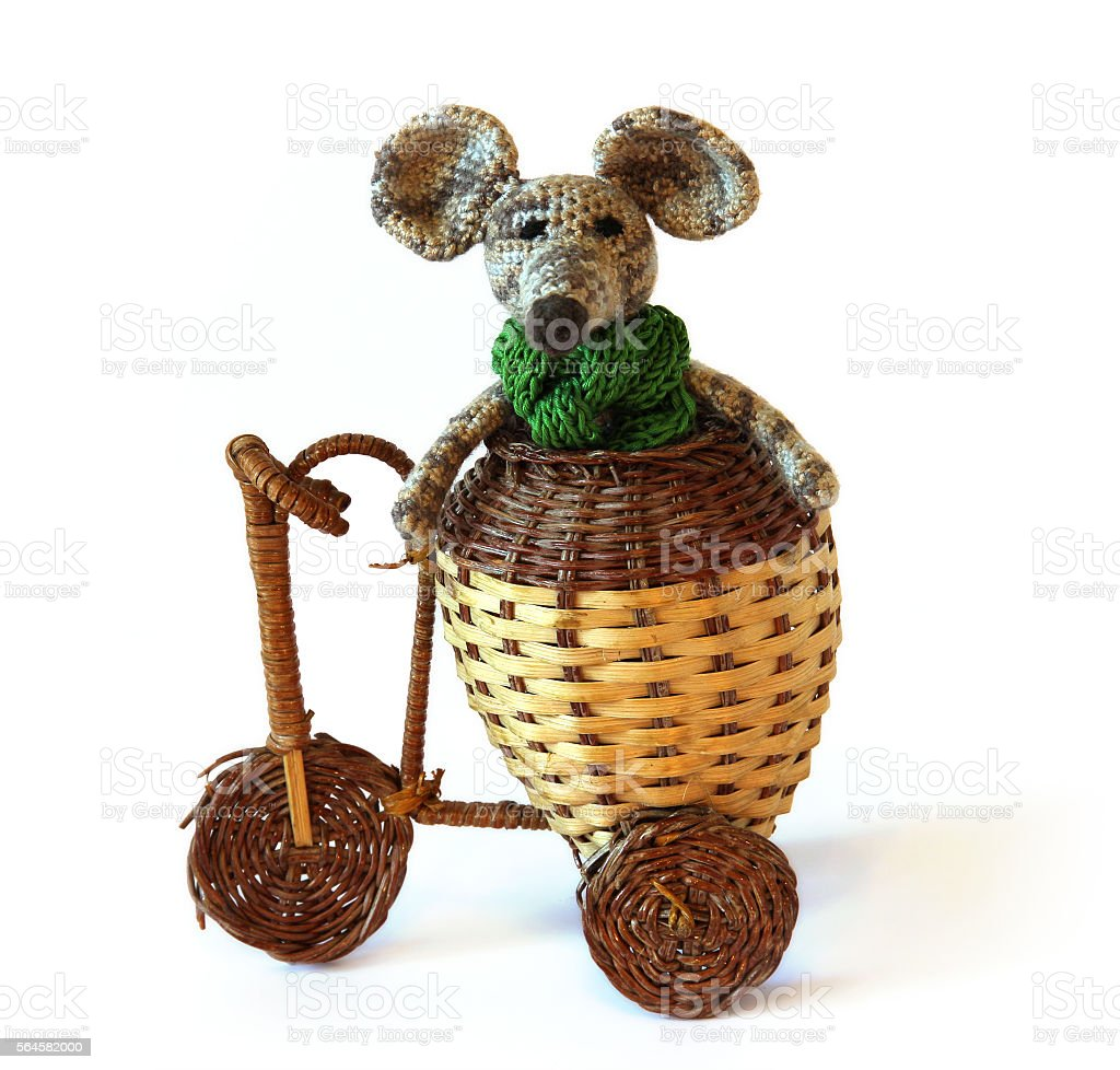 Mouse riding a bicycle stock photo