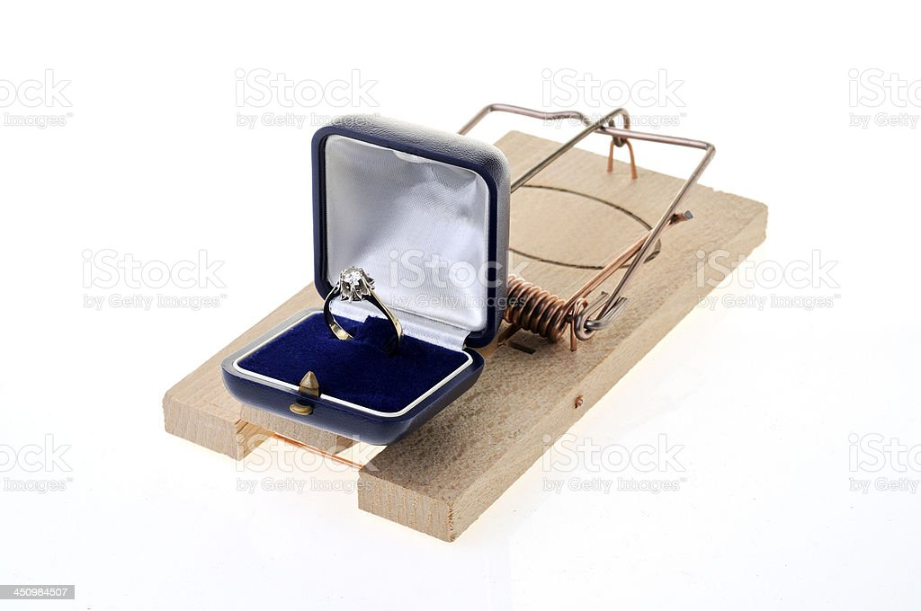 Mousetrap and diamond ring on a white background stock photo