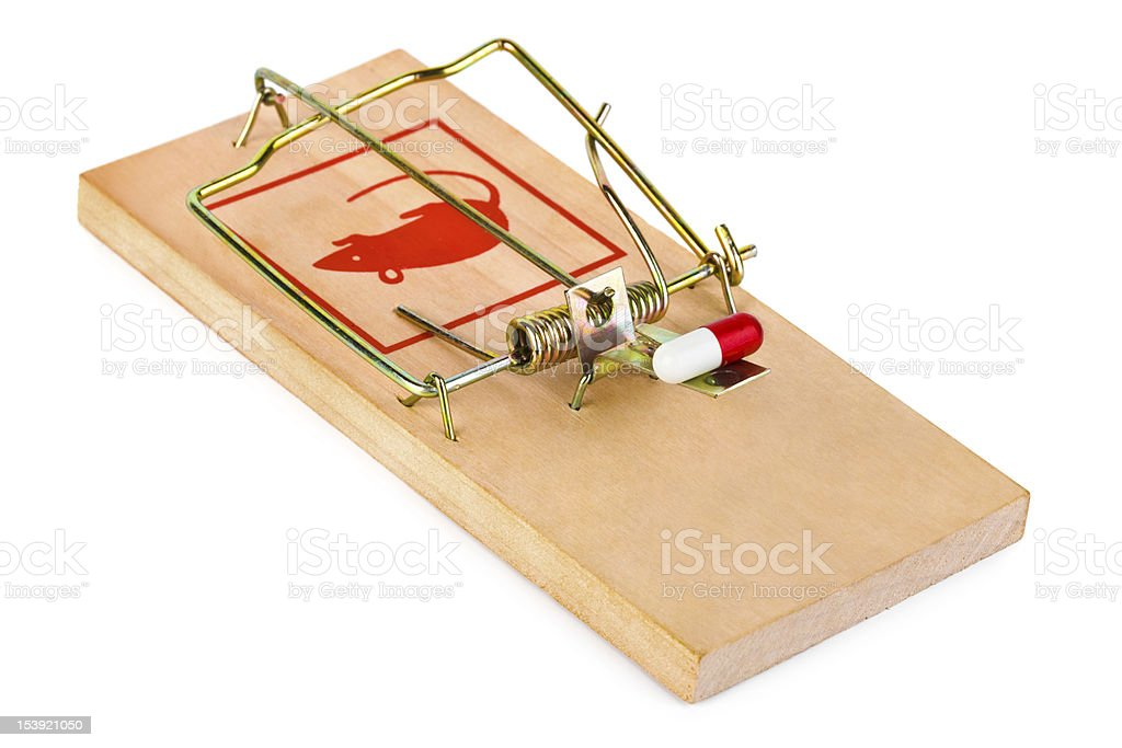 Mousetrap and pill stock photo