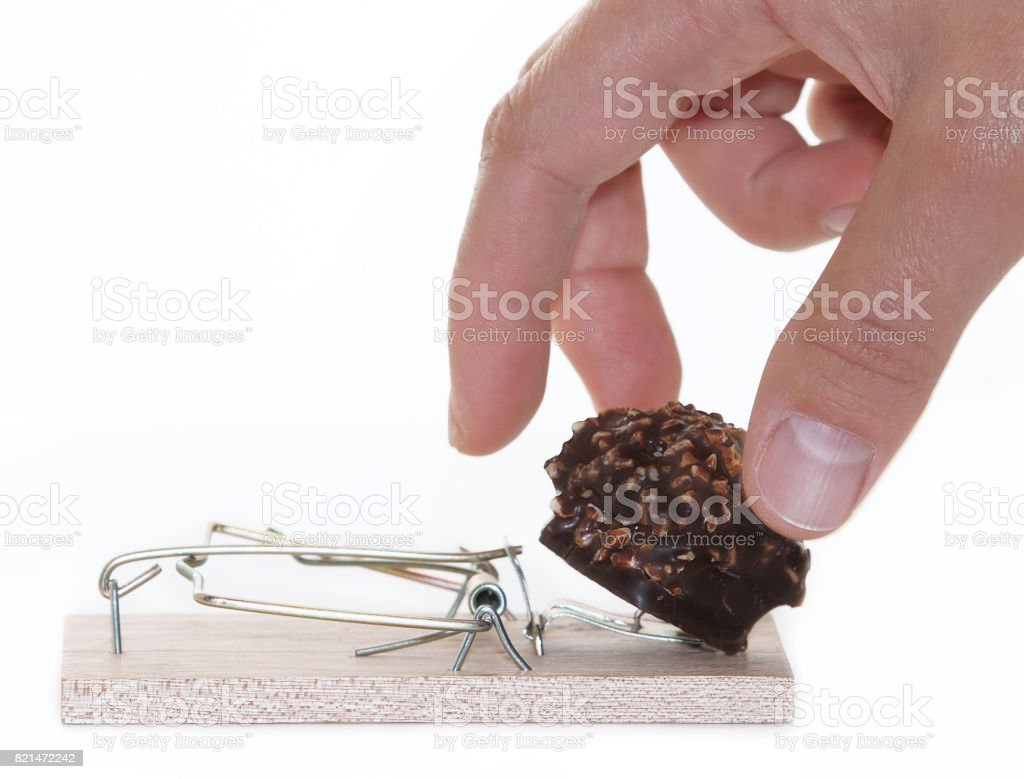 Mousetrap with chocolate isolated on white background stock photo