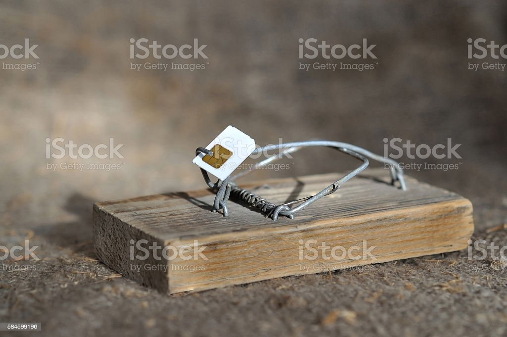 Mousetrap with the bait of a sim card stock photo