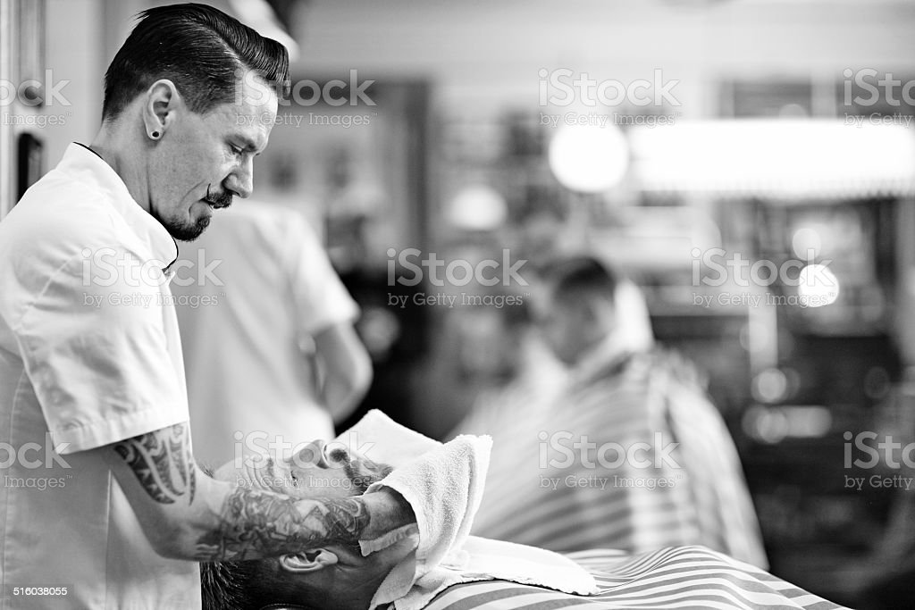 moustached barber working on client stock photo
