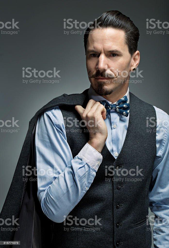 moustached classic man holding suit jacket