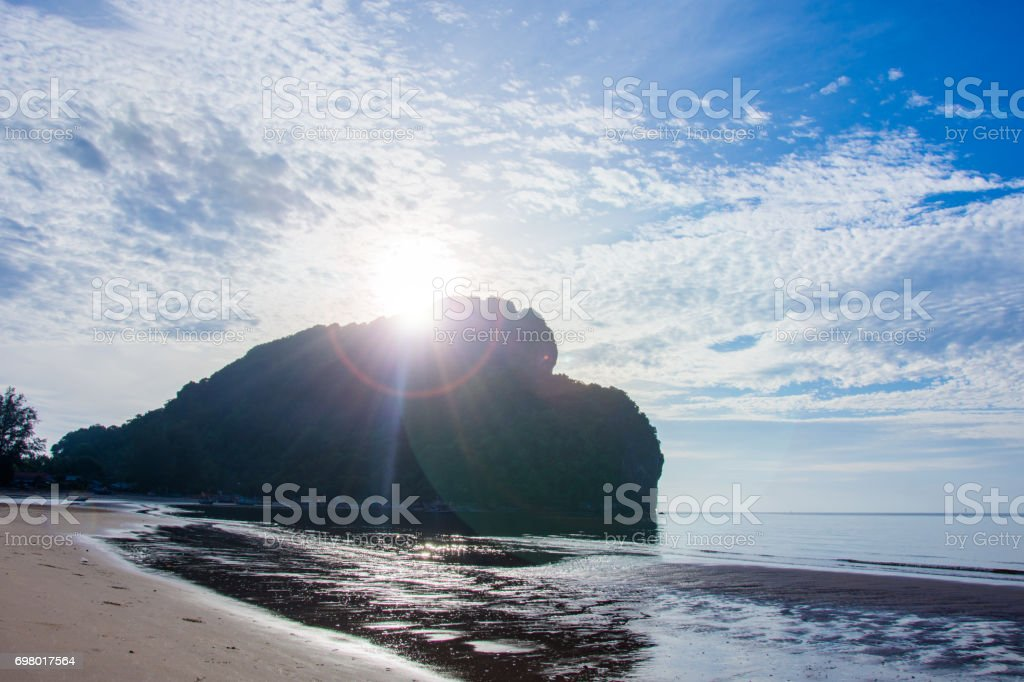 moutain and sun flare cloud in blue sky stock photo