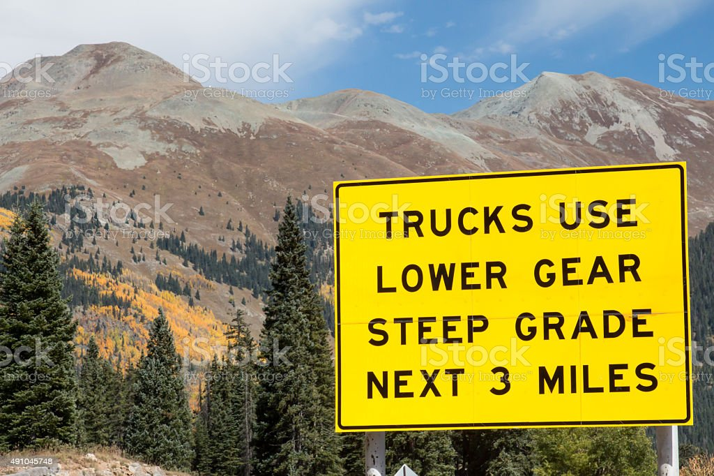 Moutain driving with a truck - warning sign stock photo