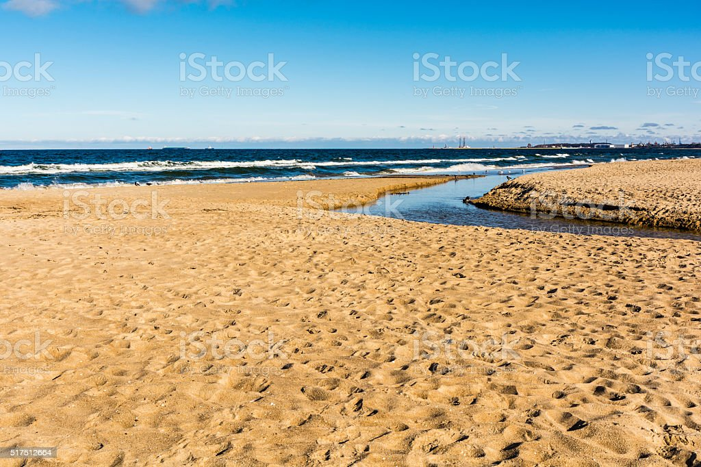 Mouth of a small river to the sea. stock photo