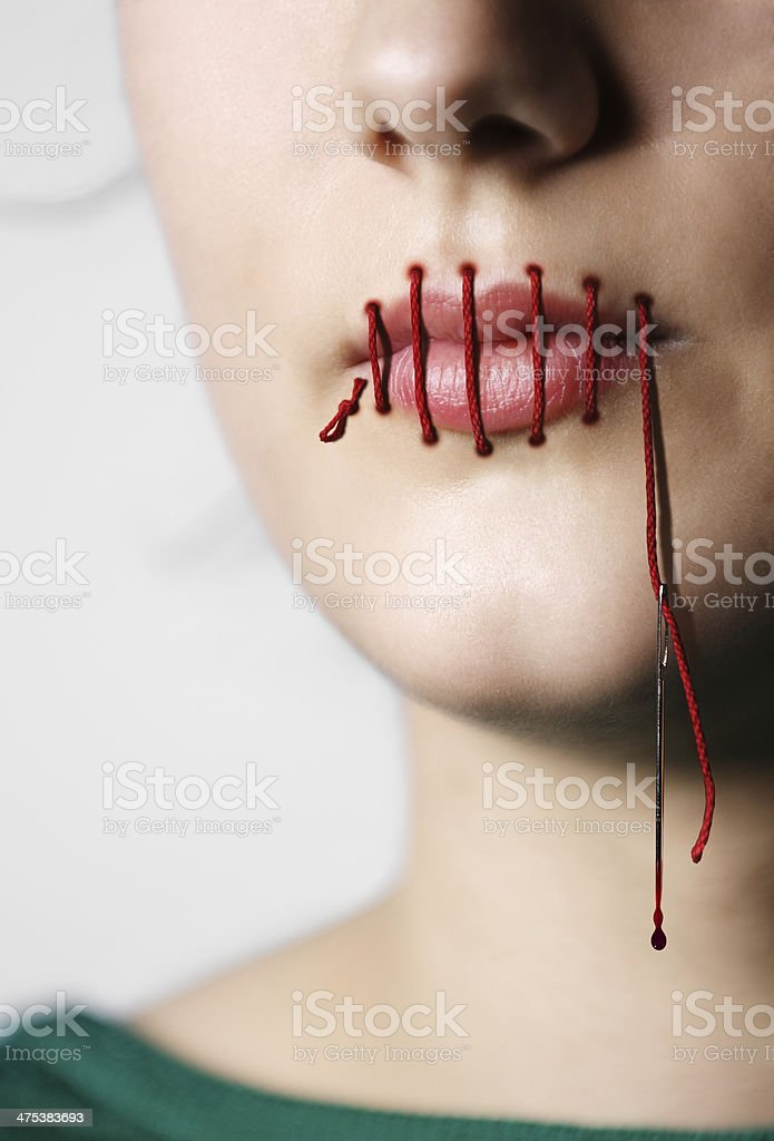 Mouth Sewn Shut stock photo