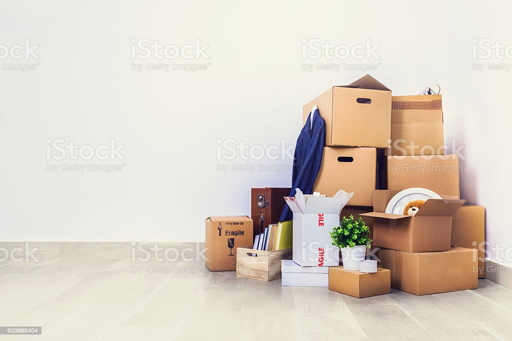 Move. Cardboard boxes in empty room corner. stock photo