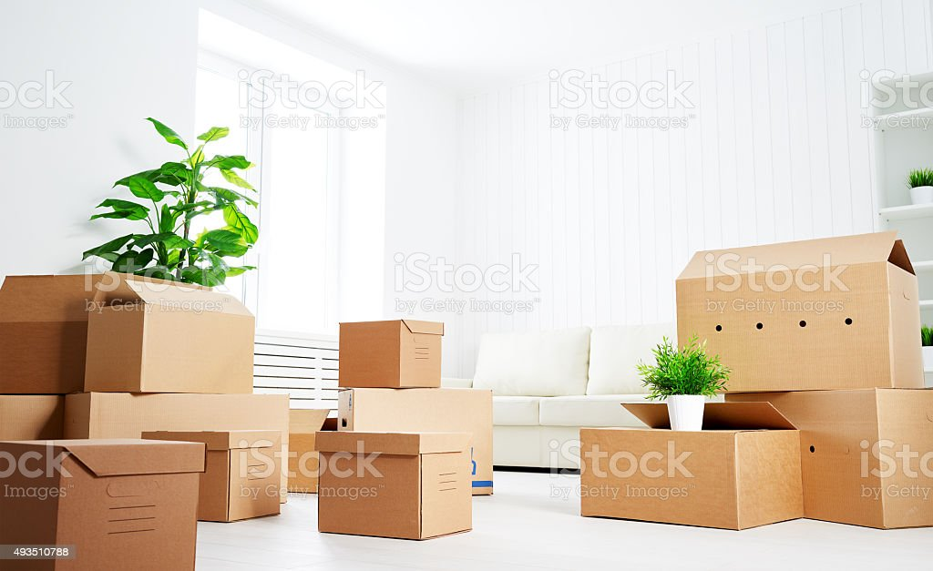 move. lots of cardboard boxes in empty new apartment stock photo