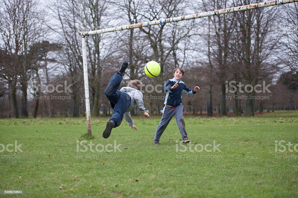 Move Scorpion freestyle soccer kid player stock photo