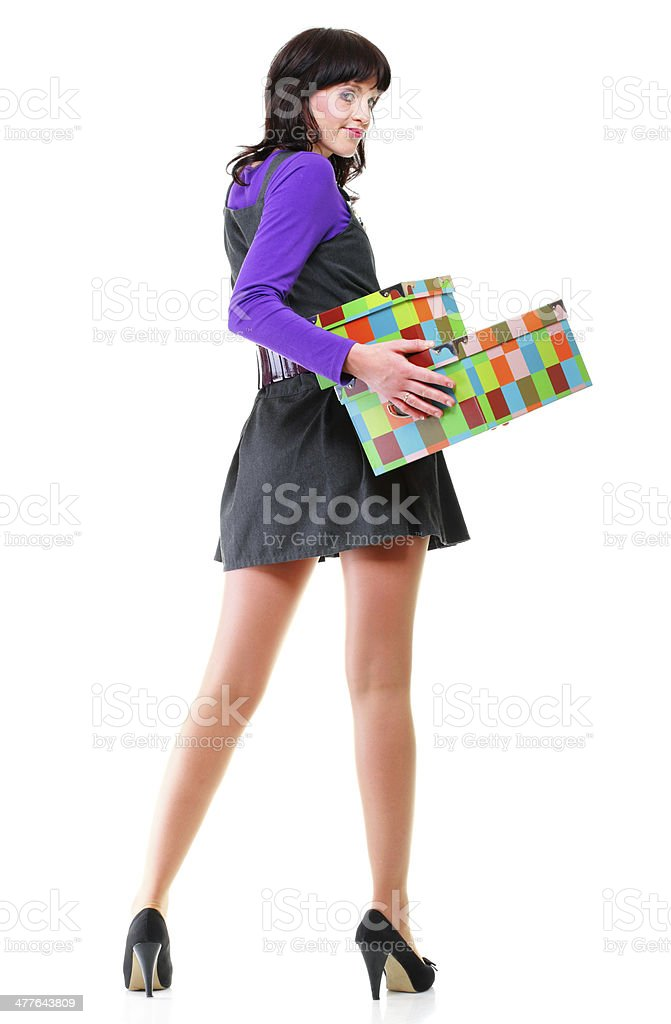 Move. Woman holding colorful boxes isolated. royalty-free stock photo