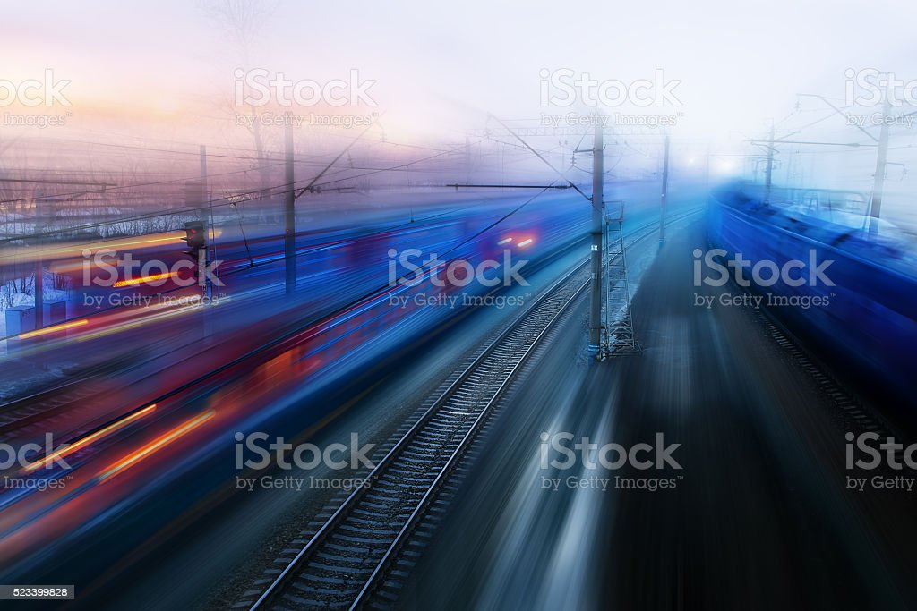 movement of trains in  ways of evening twilight fog spring stock photo
