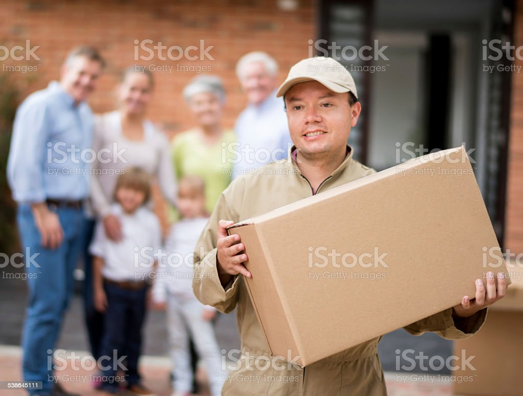 Mover carrying moving boxes stock photo