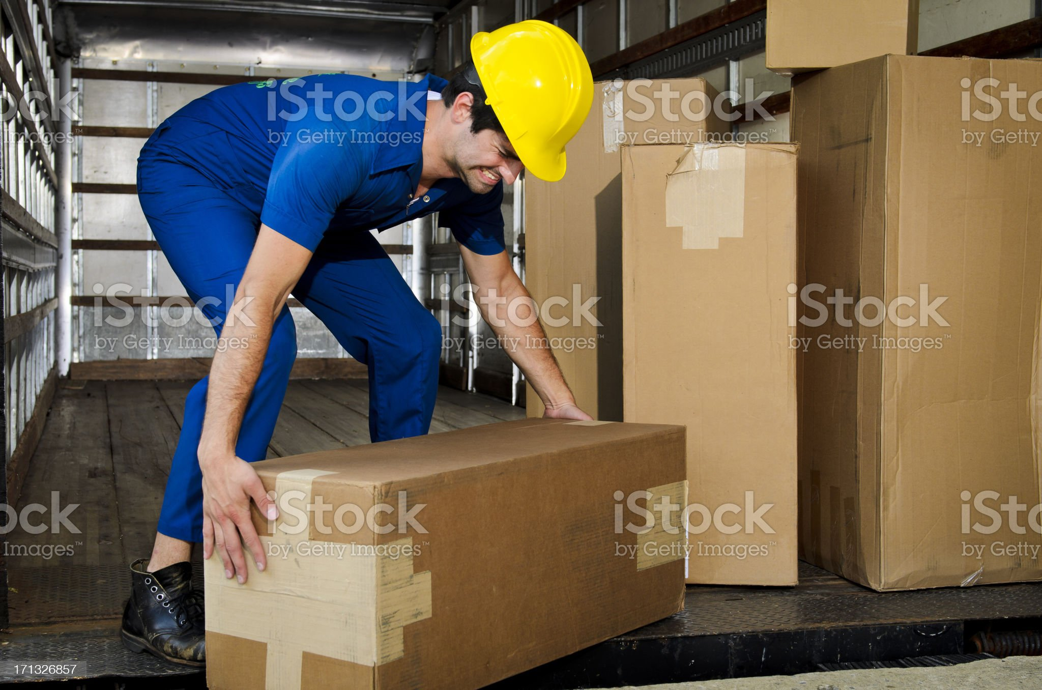 Mover Lifting a Box Incorrectly royalty-free stock photo