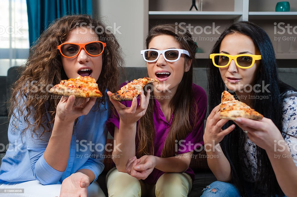 Movie and pizza time with girls stock photo