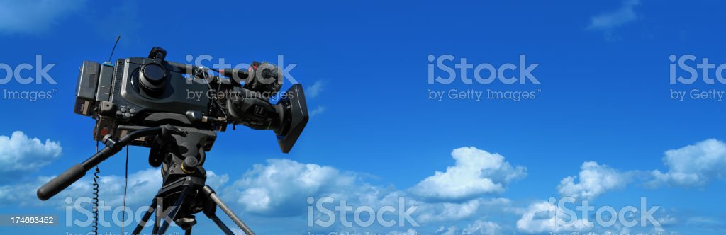 Professional Movie Camera and Blue Sky Behind. SEE