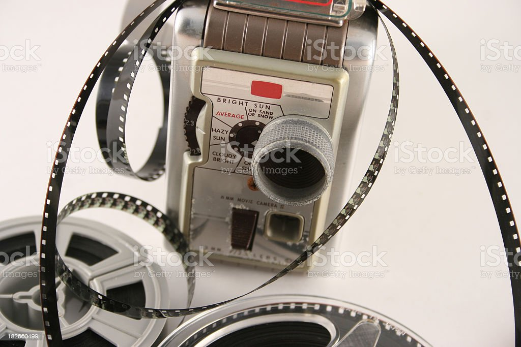 Movie camera with films royalty-free stock photo