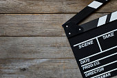 movie clapper on wood table