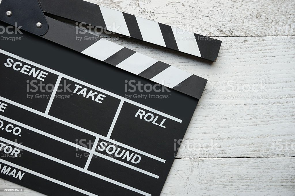 movie clapper on wood table stock photo