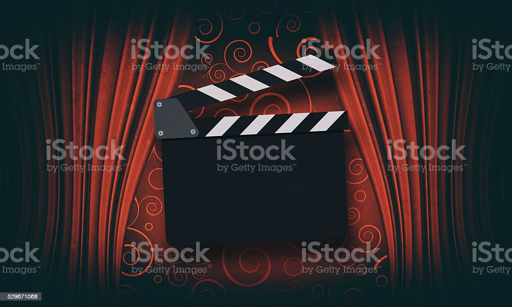 Movie clapperboard on a red stock photo