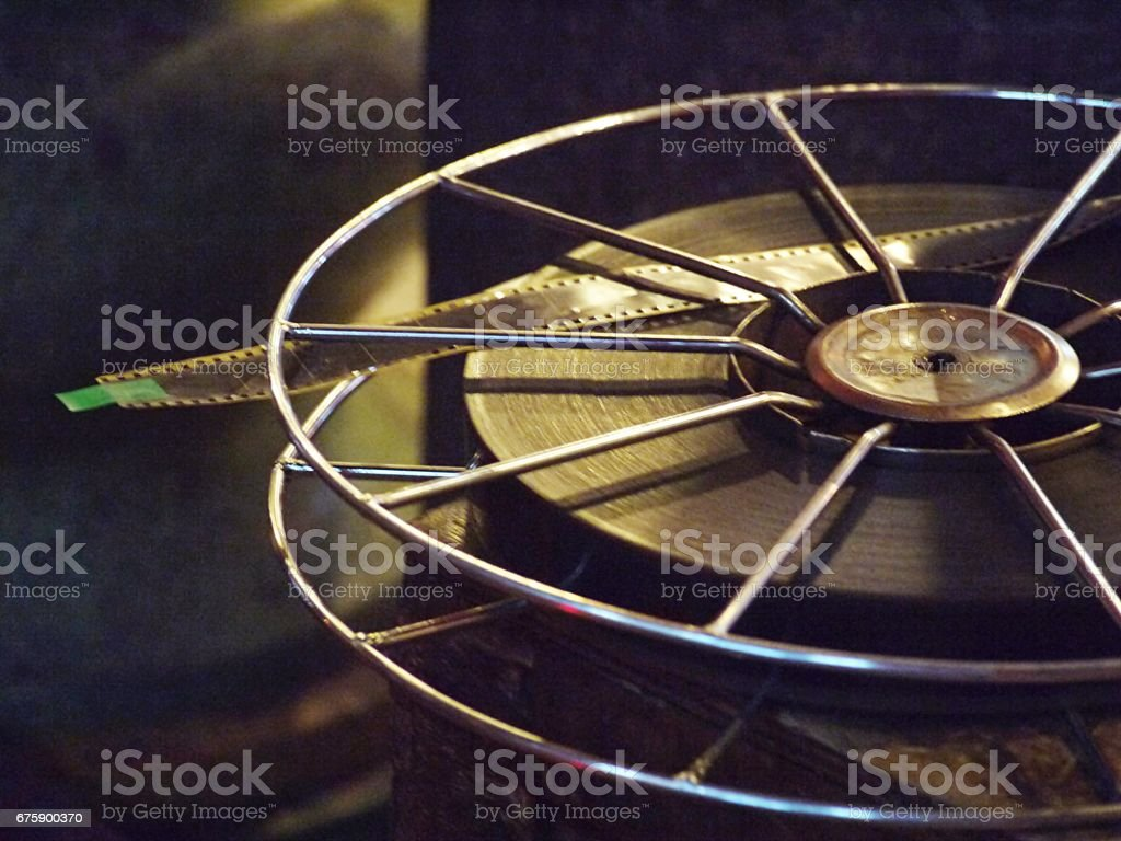 Movie film reel roll on wooden box case stock photo