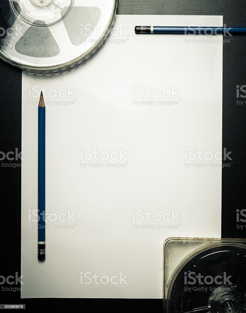 Movie Film writing with pencil on blank paper Vintage background stock photo