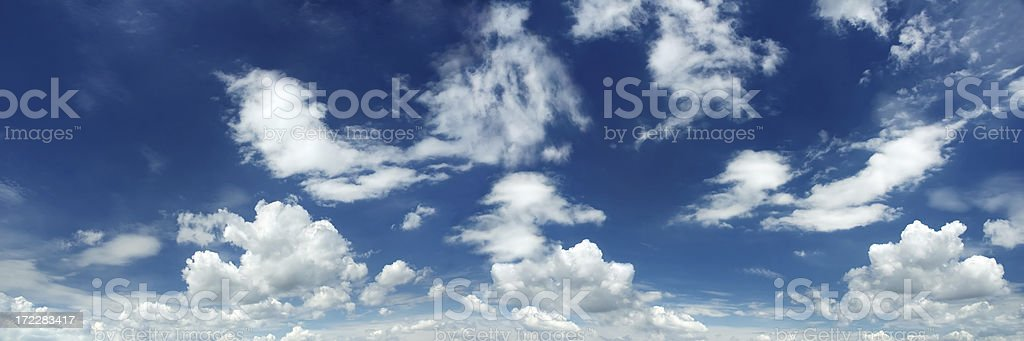 Movie like image of a blue sky with clouds royalty-free stock photo