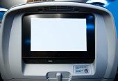 Movie Screen on Passenger Seat of Airplane
