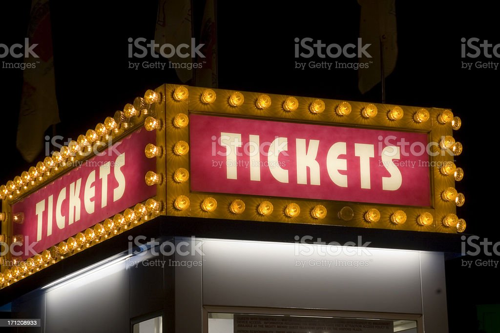 Movie Theater and Carnival Ticket Sign Lit up with Light stock photo
