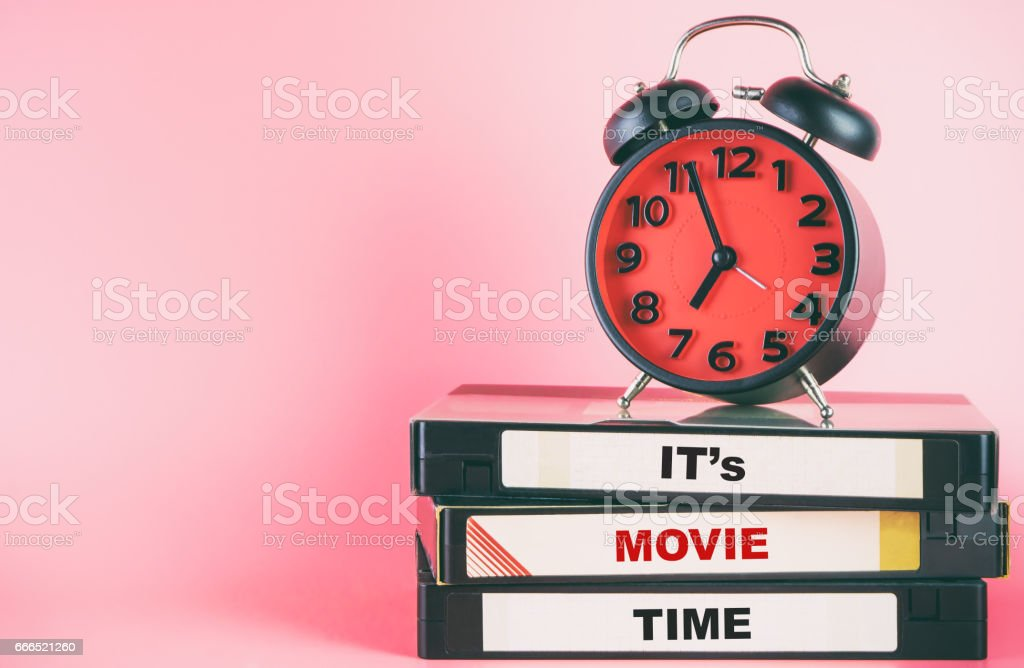 Movie time with text lable on video and clock timing stock photo