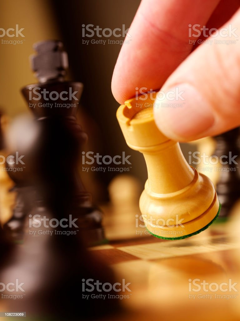 Moving a Chess Piece stock photo