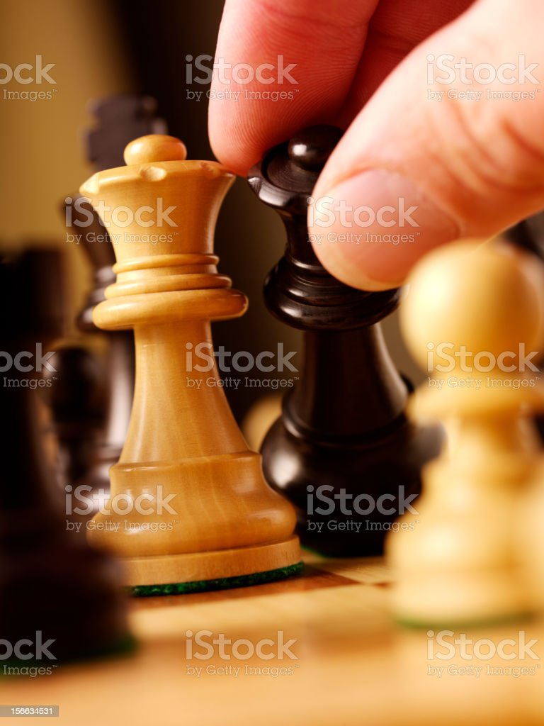 Moving a Chess Piece royalty-free stock photo