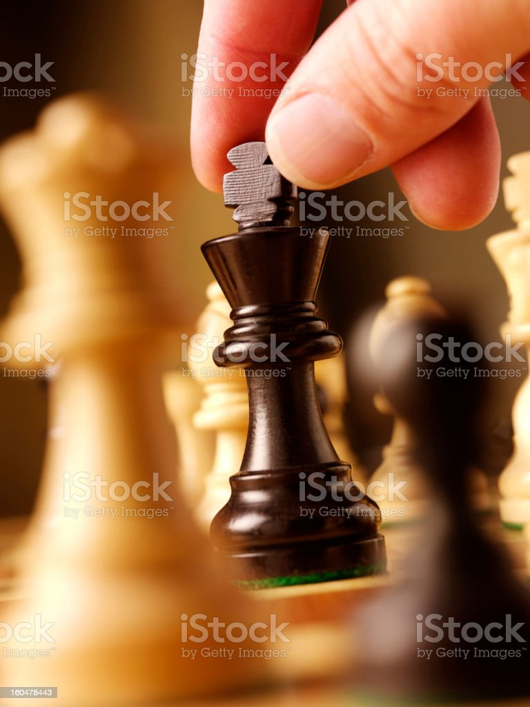 Moving a King in Chess royalty-free stock photo