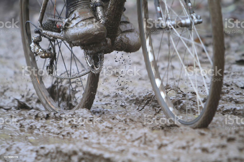 Moving Bicycle Wheels Splattering Mud stock photo