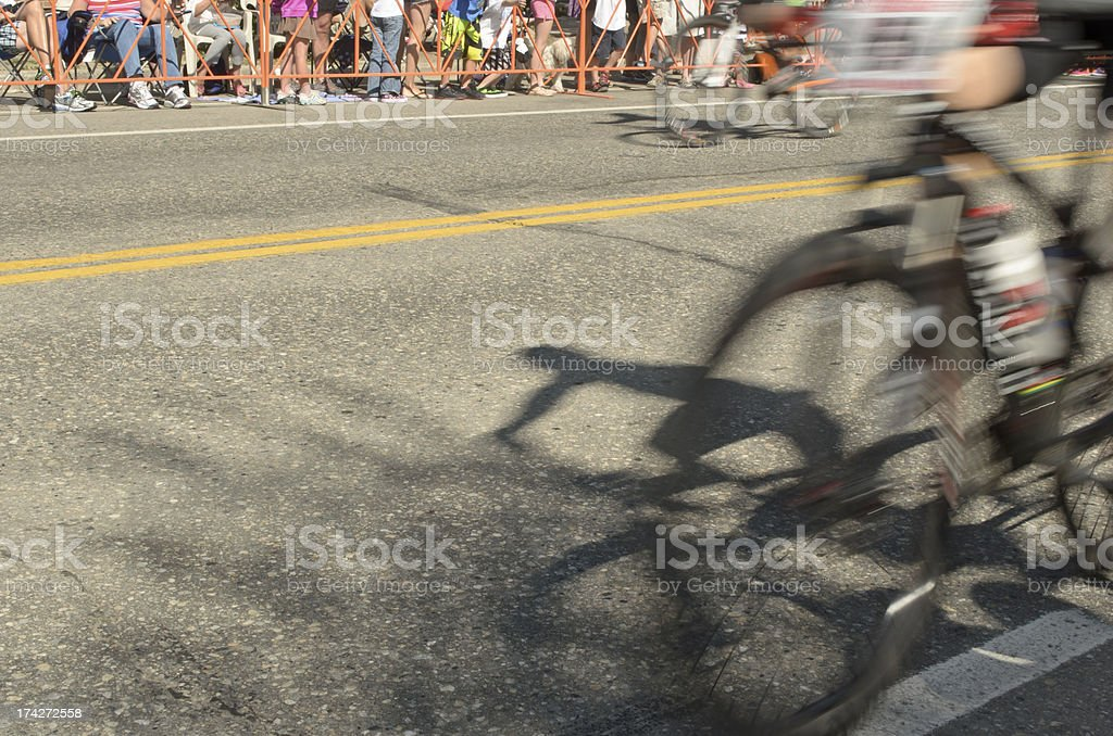 Moving bicycles racing for the Finish Line royalty-free stock photo