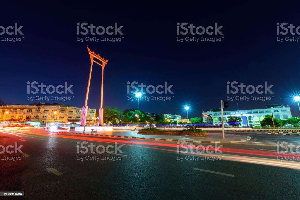 Moving blur light around the Giant swing landmark in the city stock photo
