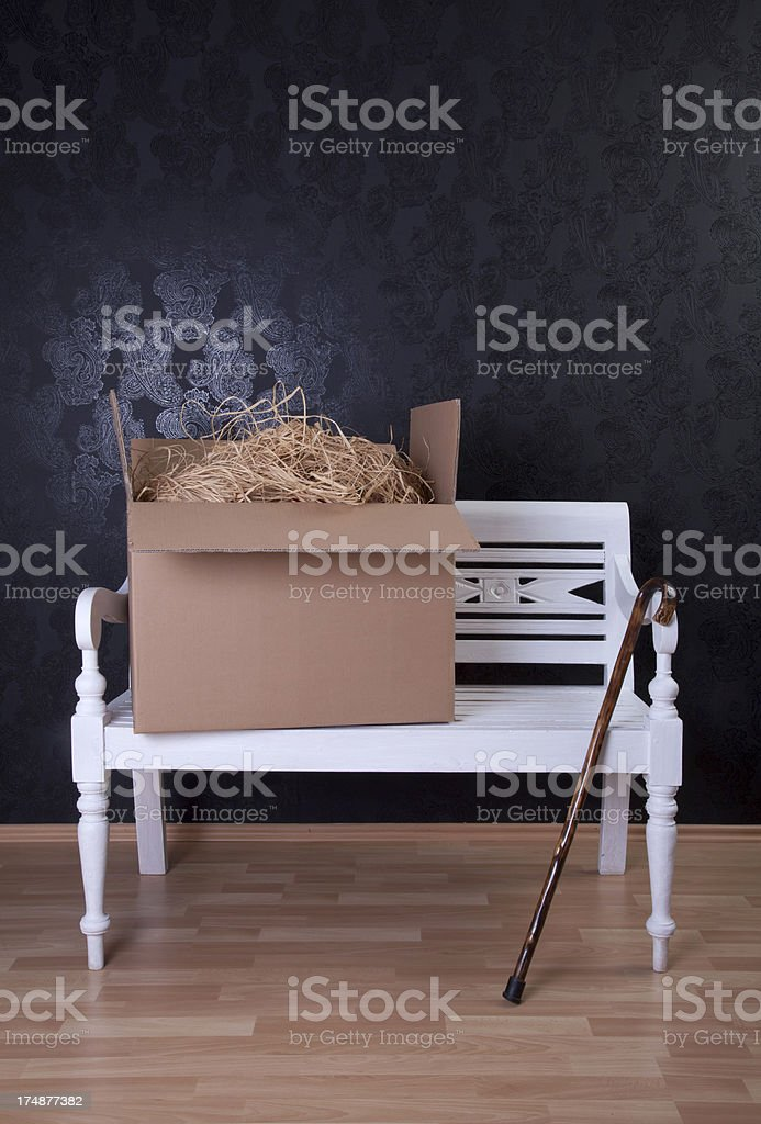 moving box and cane on white bench royalty-free stock photo