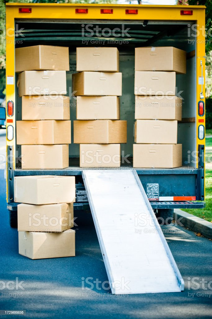moving boxes and truck from the back royalty-free stock photo
