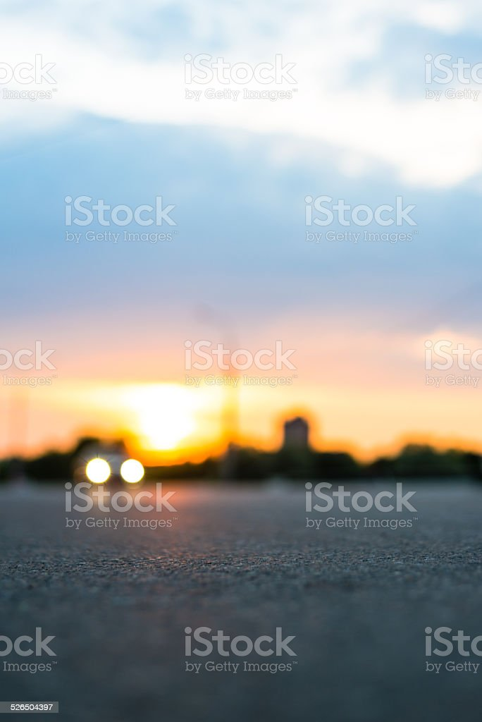 Moving car in sunset stock photo