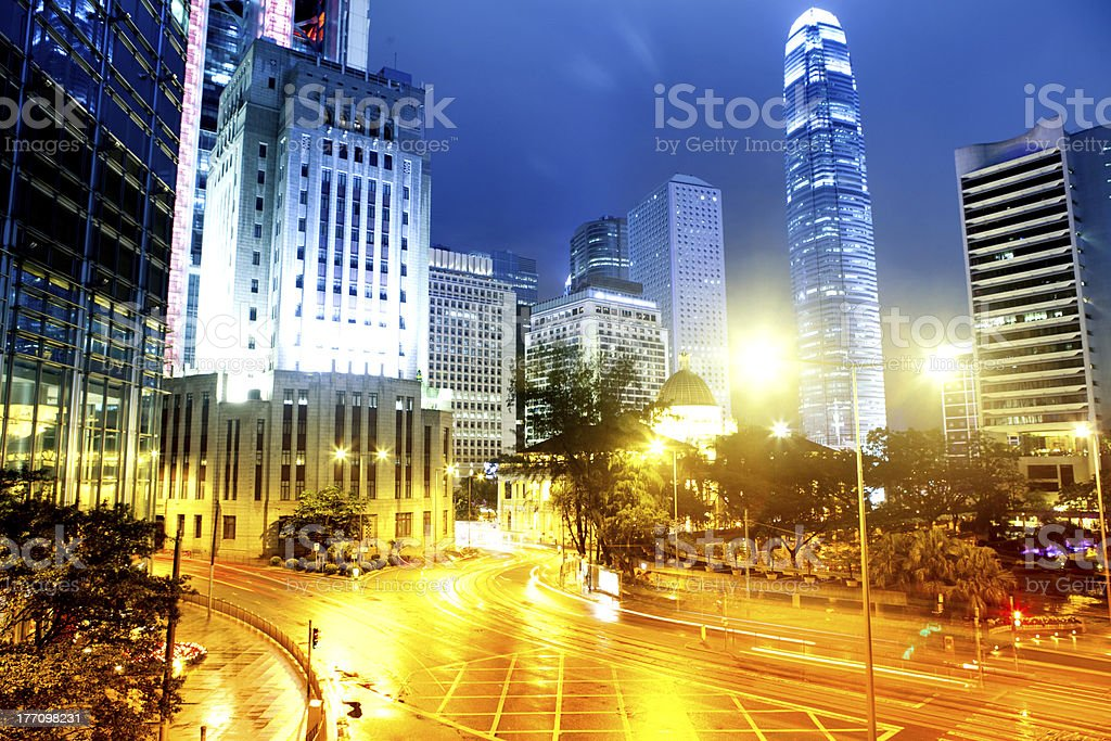 moving car with blur light through city at night royalty-free stock photo