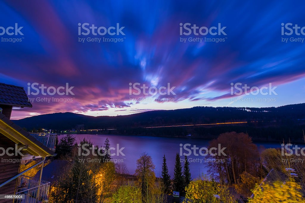 Moving Clouds over Black Forest Lake, Germany stock photo